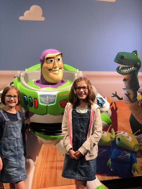 Gigi and Mo with Buzz Lightyear from Toy Story.