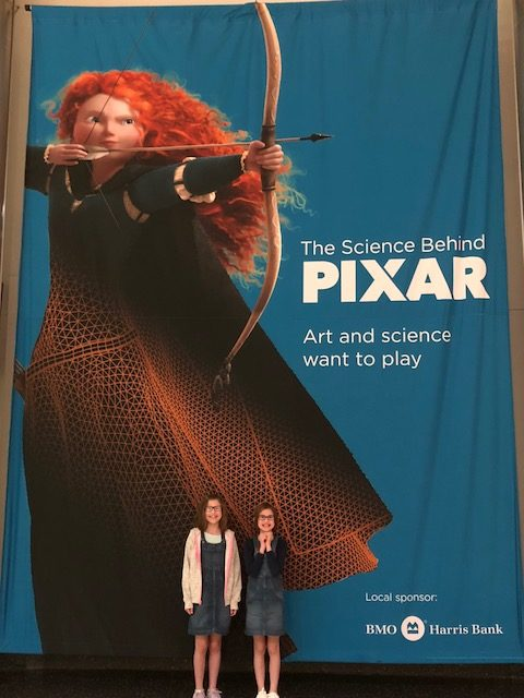 Giant poster with Merida from Pixar's Brave.