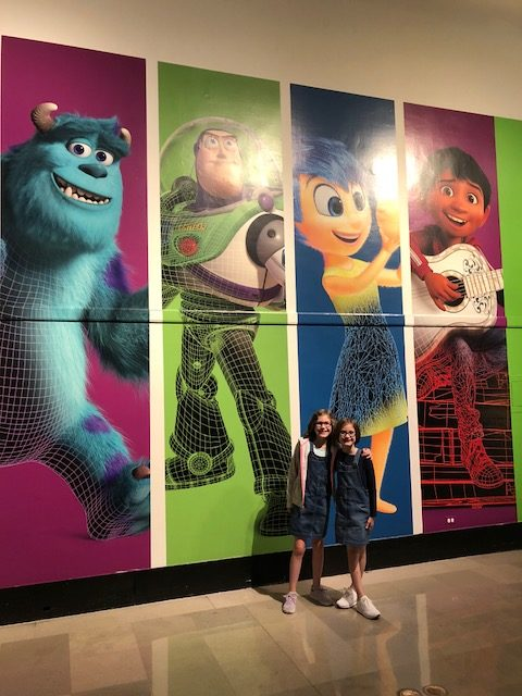 Sully, Buzz Lightyear, Joy and Coco posters.